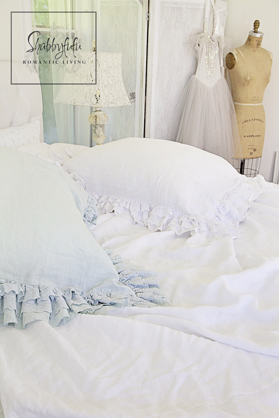 romantic room designs - soft blue and pink bed fabrics and pillows