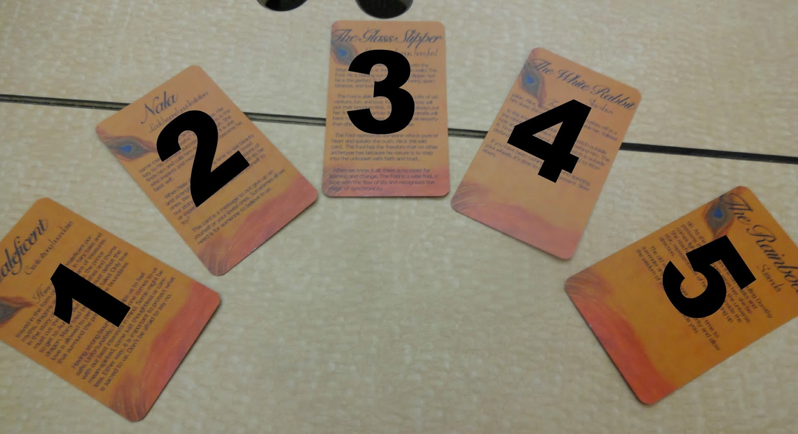 5 cards fanned out on a table