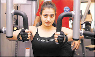 Amisha Patel Doing Weight Lifting At Gym