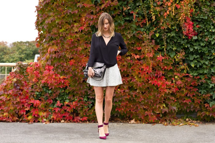 Vancouver Fashion Blogger, Alison Hutchisnon, is wearing a Zara black wrap top, Topshop skater skirt in animal print, a j.crew necklace, and zara pumps in burgundy