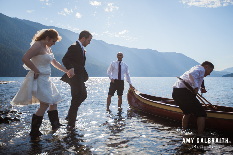 bride and groom getting into canoe