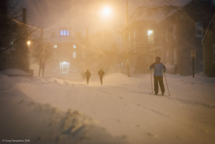 Portland, Maine USA January 2018 photo by Corey Templeton. Skiers and pedestrians take to the streets of the West End, from this evening's snow event.