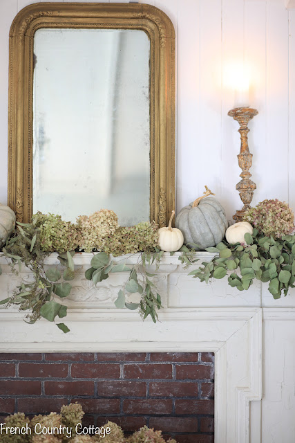 Elegant and natural autumn mantel decor