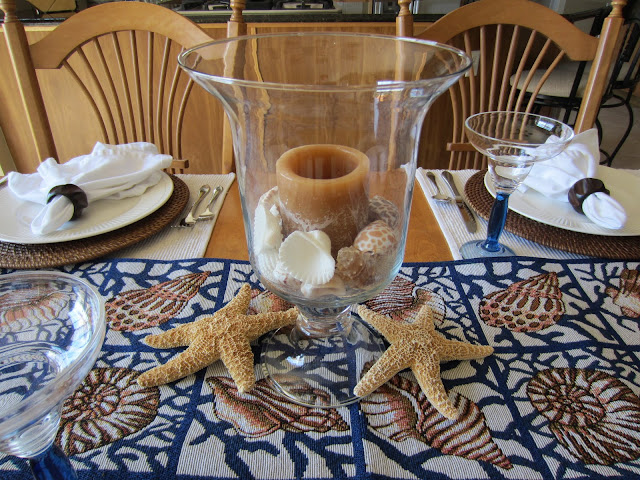 Casual Beach Table Setting - shells, starfish and coastal pieces