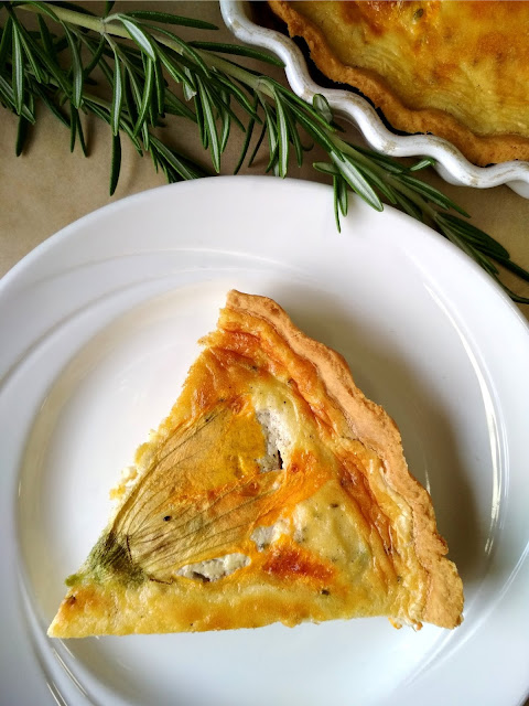 Quiche with stuffed pumpkin flowers.