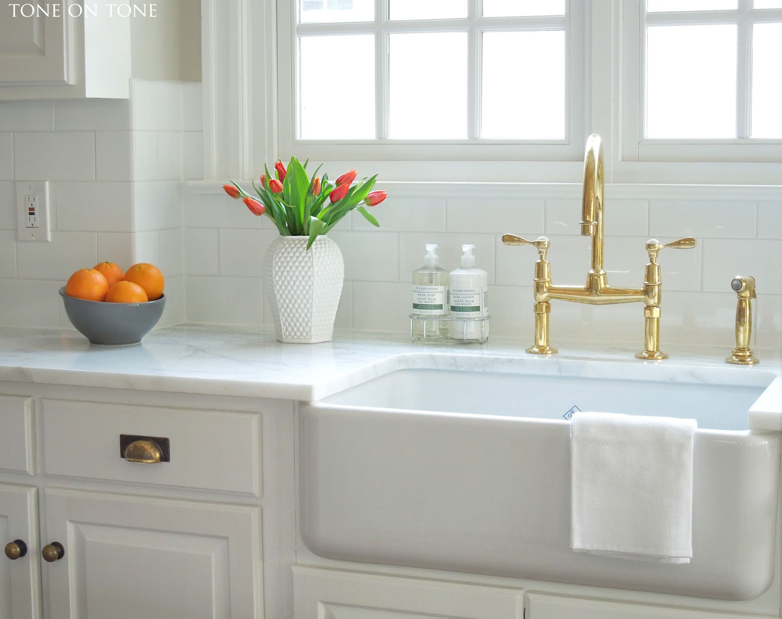 a diy chalkboard unlacquered brass kitchen faucet is the unlacquered brass faucet over a farmhouse style sink both added during the makeover I suggested the unlacquered brass finish to complement the