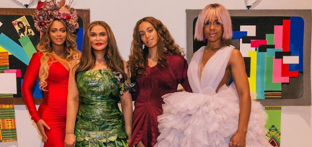 Beyoncé's Pregnancy Style Is Sizzling In A Red-Hot Gown And Headpiece