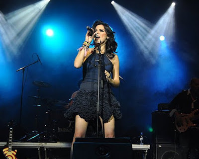 Foto de Maité Perroni en concierto