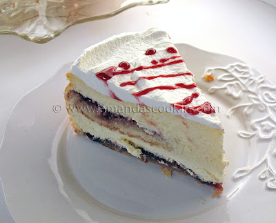 A close up photo of a slice of English trifle cheesecake.