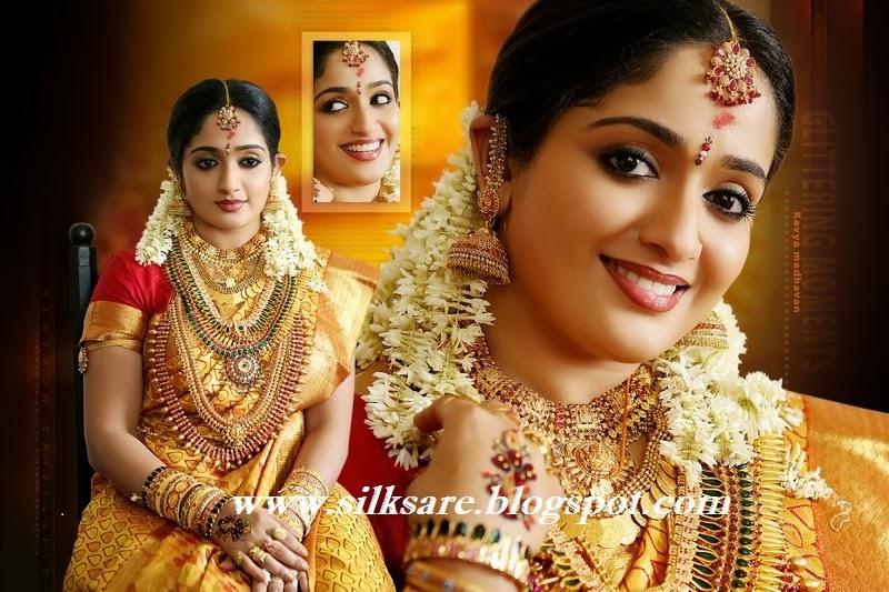 wedding saree in south Indian actress kaviya madhavan