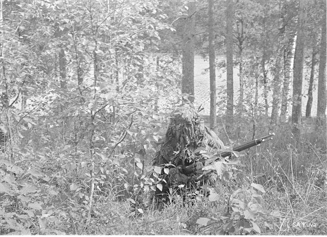 A Finnish marksman with a Mosin-Nagant rifle, 4 August 1941 worldwartwo.filminspector.com