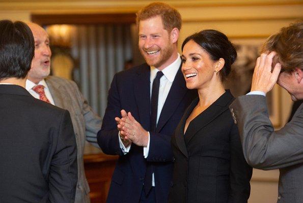 Meghan Markle wore Judith & Charles Digital Dress, Paul Andrew pumps, carried Jimmy Choo clutch. Prince Harry
