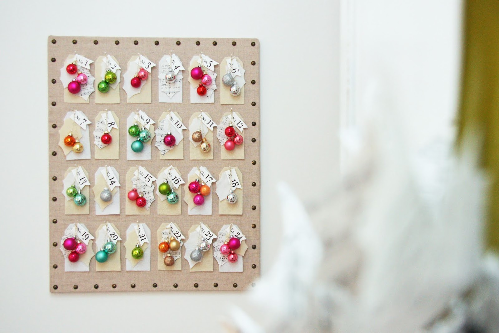 Pretty advent calendar on bulletin board