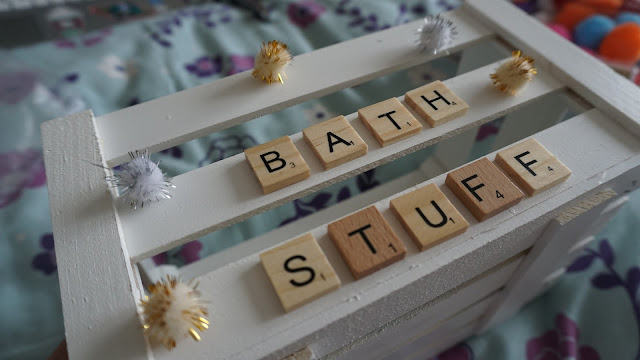 Wooden letter tiles attached to a white crate with a glue gun