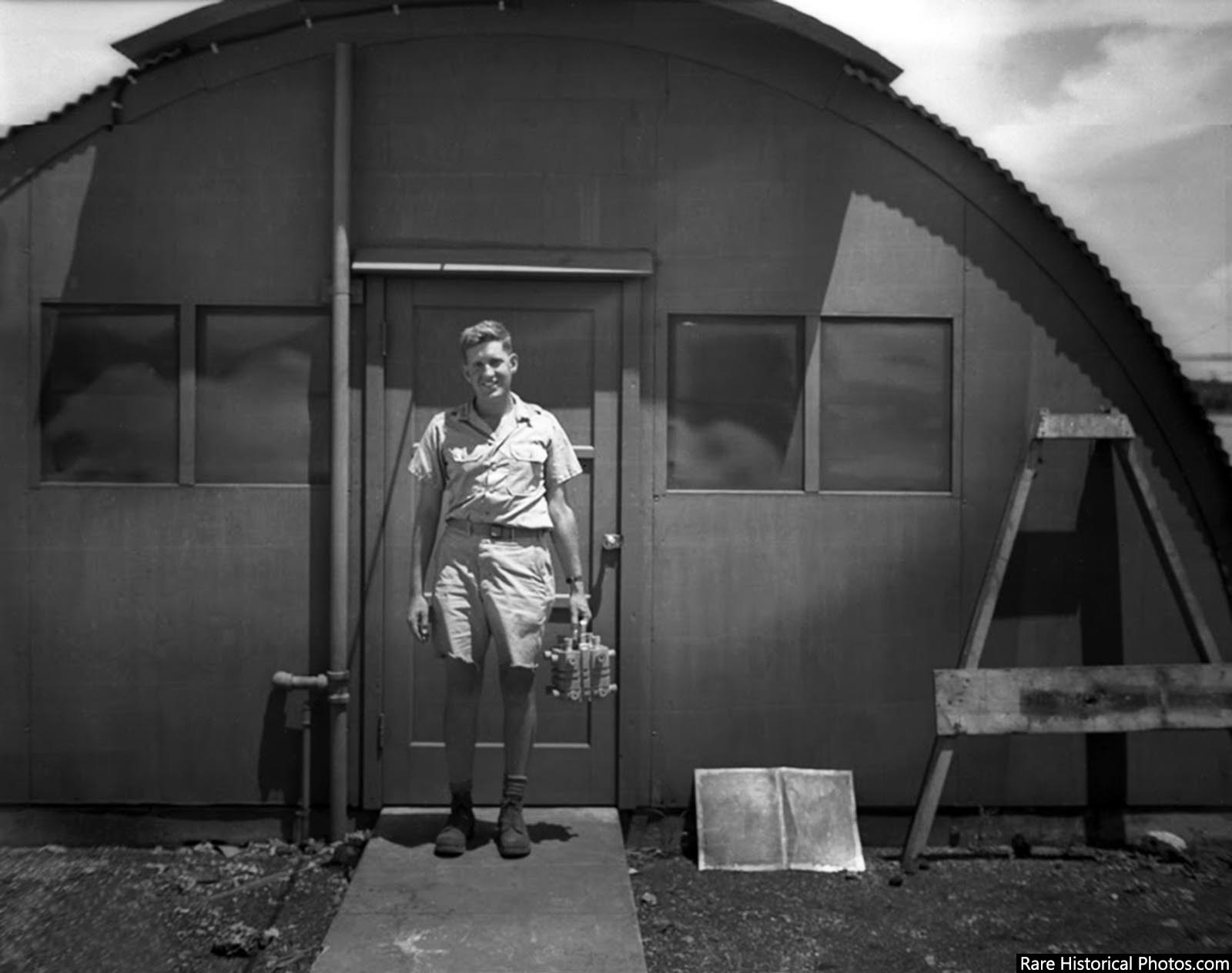 Harold Agnew on Tinian in 1945, carrying the plutonium core of the Nagasaki Fat Man bomb.