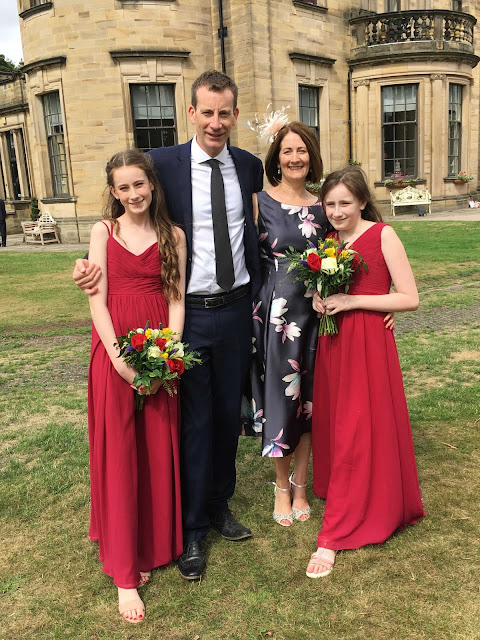 our family in wedding outfits