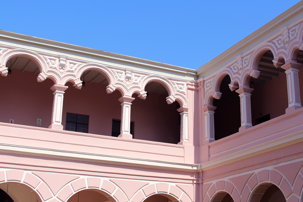 Pretty pink building in Lima, Peru - travel & lifestyle blog