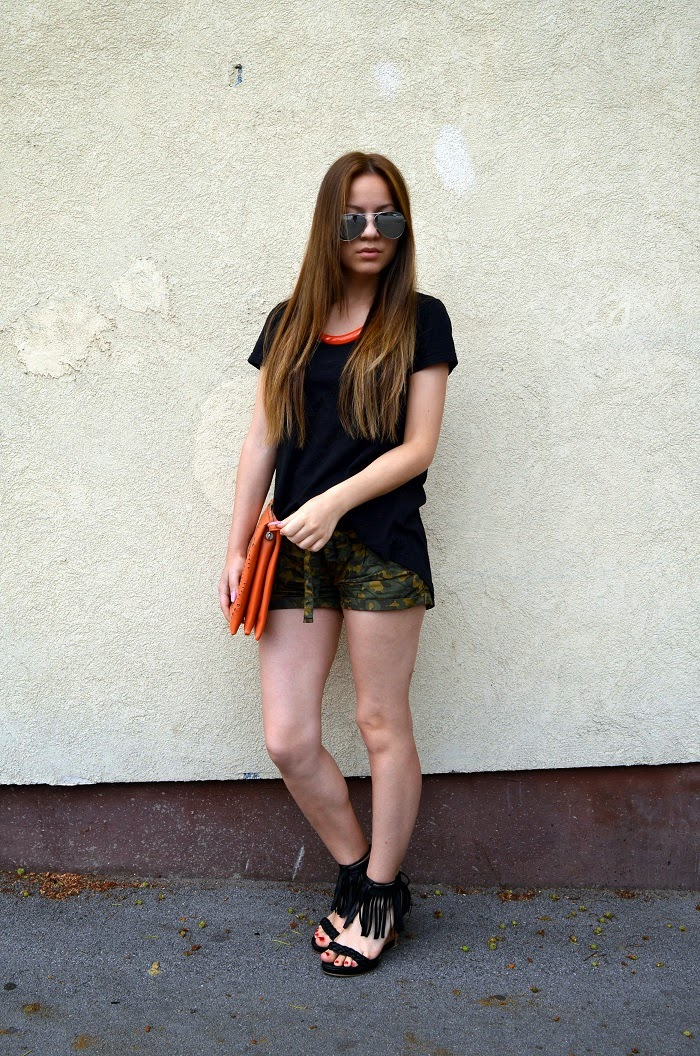 outfit, camo print shorts, black fringe tassels wedge sandals heels, orange necklace, black t-shirt, aviator sunglasses