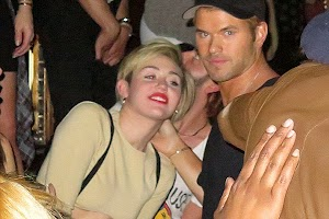 Miley Cyrus and Kellan Lutz kissing at a party in Vegas