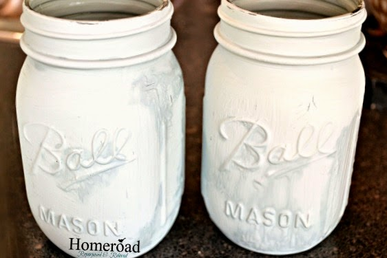 coat of light blue paint on mason jars