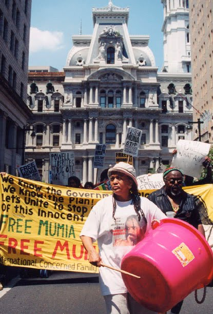Pam Africa leads a Free Mumia demonstration past Philadelphia City Hall (July 4, 2002)