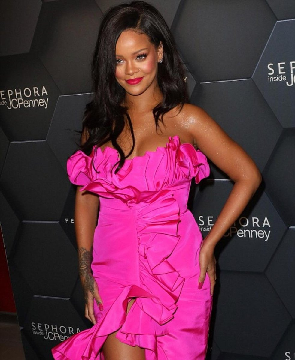 Rihanna is wearing a Calvin Klein By Appointment dress and Harry Kotlar earrings