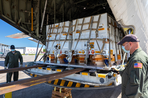 5,000 pounds (2,270 kilograms) of flight hardware devoted to the Mars 2020 mission are unloaded from a NASA Wallops C-130 aircraft at the Kennedy Space Center in Florida...on May 11, 2020.