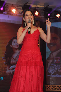 Tamanna Pictures in Red Long Dress at Thozha Movie Audio Launch ~ Celebs Next