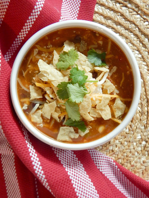 Instant Pot Chicken Enchilada Soup....an easy, quick meal in your Instant Pot or on your stove-top.  All the flavors of an enchilada in a bowl. (sweetandsavoryeats.com)