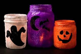 upcycle old jars or vases and make Halloween candle goblins