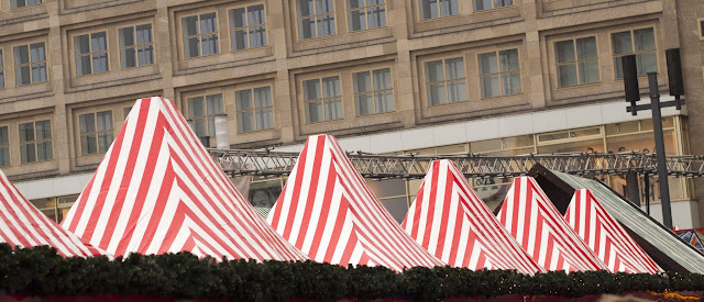 Red-striped tents at the Alexanderplatz Christmas Market in Berlin, Germany