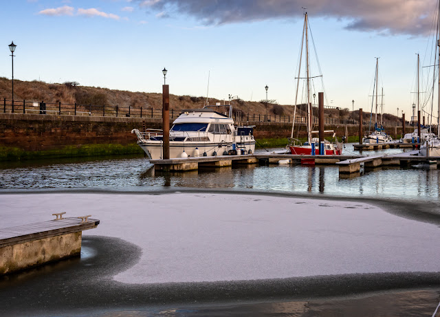 Photo of Ravensdale and snow on the iced-over water at Maryport Marina in Cumbria, UK