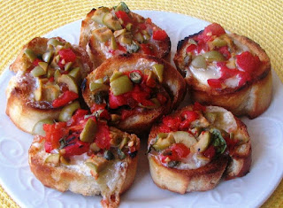 http://www.thepeppermillinc.com/Browse/Product/3656/86/Roasted-Pepper-Olive-and-Mozzarella-Bruschetta