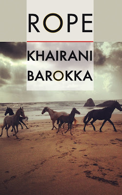 The cover of this book is 'Life, Agonda Beach', a photograph of five wild horses running in a circle on Agonda Beach in Goa, under cloudy skies. Three are dark brown, and two are whitish grey. On the edge of the sea to the right, behind the horses, is a stone formation made of two boulders, one flat and wide, one stouter and smaller. The water is calm, waves are lapping. There is a logo for Nine Arches Press.
