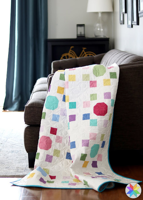 """Spot On quilt pattern by Andy of A Bright Corner - perfect for precut 10"""" squares.  Pattern has four sizes - crib, throw, twin, queen"""
