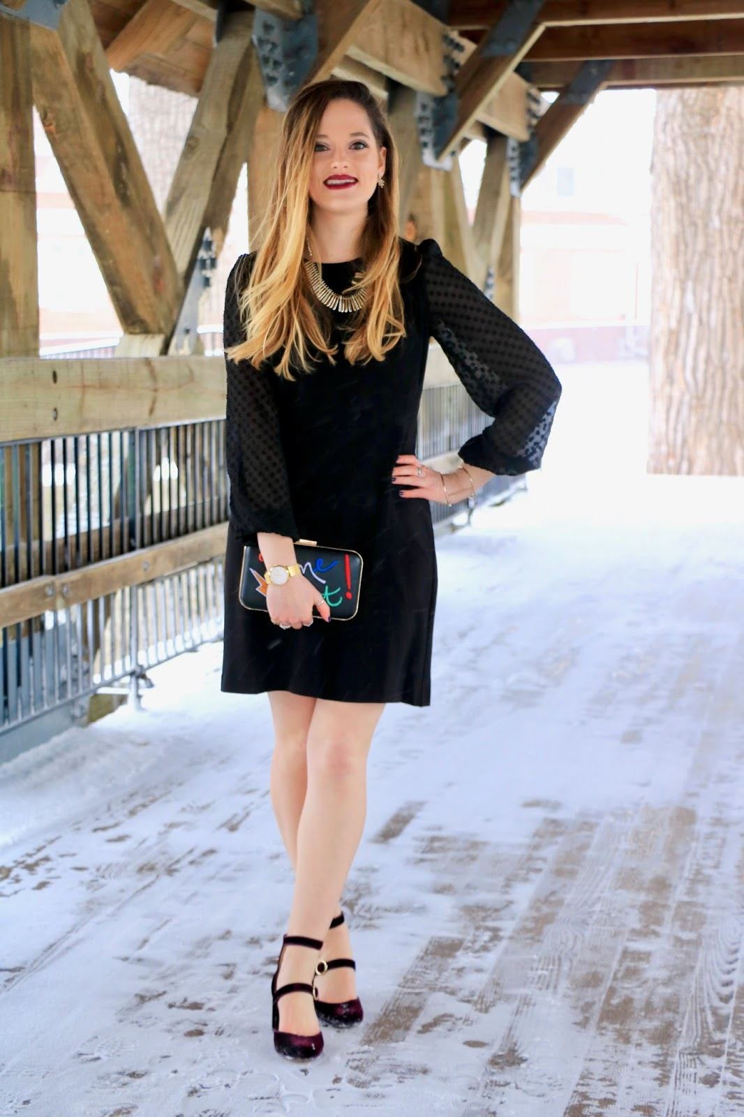 Nyc fashion blogger Kathleen Harper wearing a black dress with sheer sleeves
