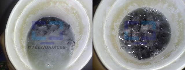 Teclas remojando en recipiente con agua y jabon.