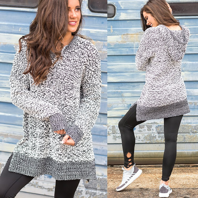 black and white fizzy pullover with leggings and sneakers