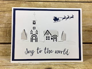 This navy and white Christmas card uses Stampin' Up!'s Hearts Come Home stamp set and Hometown Greetings Edgelits (bundle!).  We also used Clear Wink of Stella on the trees.  The top fo the church is secured down with a Mini Glue Dot.  #stamptherapist #stampinup www.stamptherapist.com