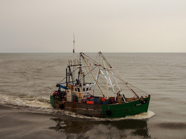 Photo of a fishing boat returning home to Maryport