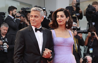 George Clooney reveals his lawyer wife Amal has also faced sexual harassment at work as he claims abuse is not just Hollywood's problem but rife in all industries