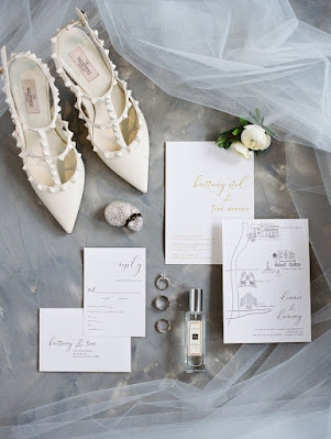 white wedding shoes and wedding stationary