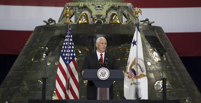 Vice President Mike Pence speaks before an audience of NASA leaders, U.S. and Florida government officials, and employees inside the Vehicle Assembly Building at NASA's Kennedy Space Center in Florida. Pence thanked employees for advancing American leadership in space. Behind the podium is the Orion spacecraft flown on Exploration Flight test-1 in 2014. Credits: NASA/Kim Shiflett