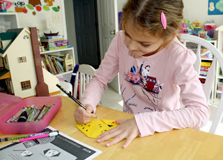 "Tessa had a lot of fun with IFAW's ""Animal Explorers: Dogs & Cats"" activity booklet. She especially enjoyed making the simple origami dog on the last page."