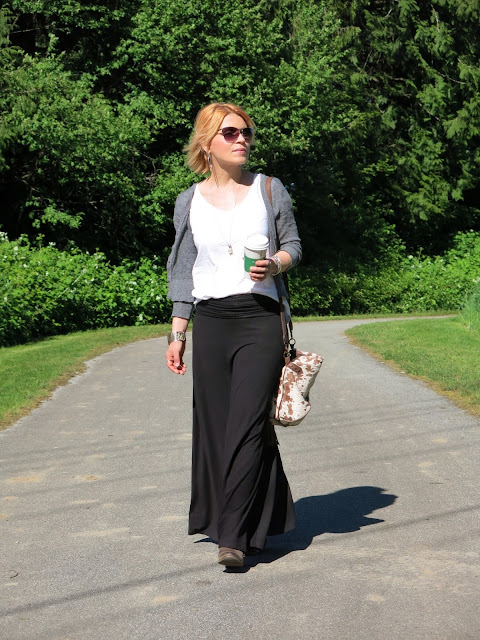 styling a black jersey maxi skirt with a slouchy white tee and shrunken cardigan