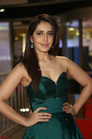 Raashi Khanna in Dark Green Sleeveless Strapless Deep neck Gown at 64th Jio Filmfare Awards South ~  Exclusive 111.JPG