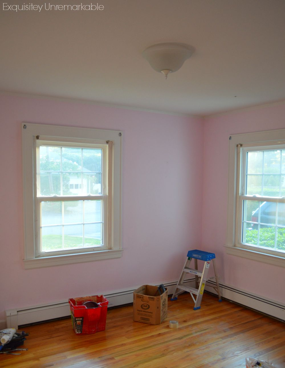 Pink bedroom being updated with white moulding