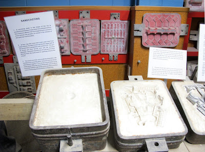 Display showing how metal toys are sandcast.