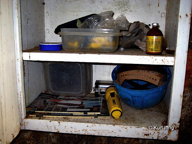 A storage cabinet in the Gold Queen Mine still has several mining related items.