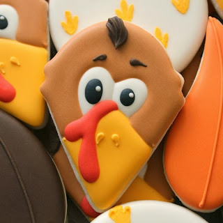 http://www.sweetsugarbelle.com/2013/11/decorated-turkey-face-cookies/